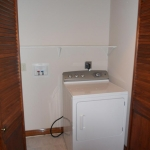 Washer and dryer closet. Dryer stays with the property.