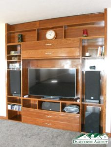 Built-in entertainment center in the living room - check out the next pictures to see the behind the center hidden cord storage and plug-ins.