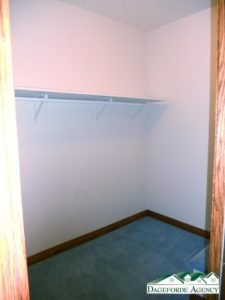 Master bedroom closet has a bench just inside the right side.
